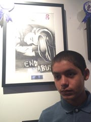 """Isaac Ruiz was awarded second-place in the contest for his drawing """"End Abuse."""""""