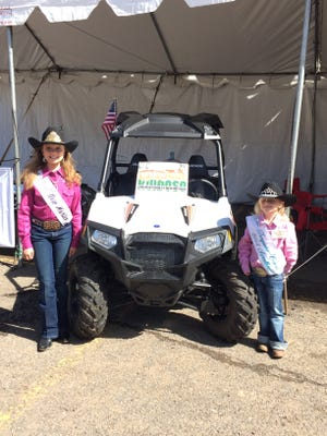 Little Miss Rodeo New MeixocTylie Garrison  and Eastern New Mexico State Fair Pee Wee Princess Alyssa Singer with the Toys for Tots RZR ATV