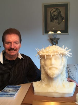 John Eagan with his life-sized bust of Jesus.