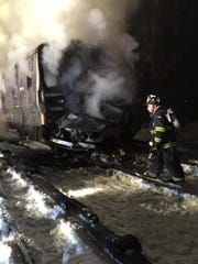 A Metro-North train burns after striking a vehicle Feb 3 just north of Commerce Street in Valhalla.
