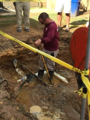 Crews look at a faulty water line at Wetumpka Middle School, which burst three times in three days.