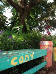 A bench painted by Cody, the child who inspired the