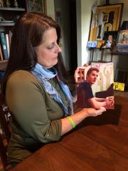 Jeanette Penny is pictured here with a photograph of her son, taken on Mother's Day 2014 while he was in a drug rehabilitation facility. He died later that year.