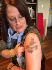 Jeanette Penny has a tattoo in honor of her son, Kevin.