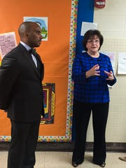 New York State Education Commission MaryEllen Elia talks with teachers in the hallway of Northeast Elementary School Friday morning. Ithaca City School District Superintendent Luvelle Brown is at left.