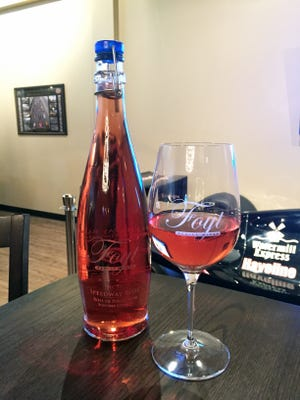 Foyt Wine Vault in Speedway launches a Rose and wine keg system, with refillable growler.