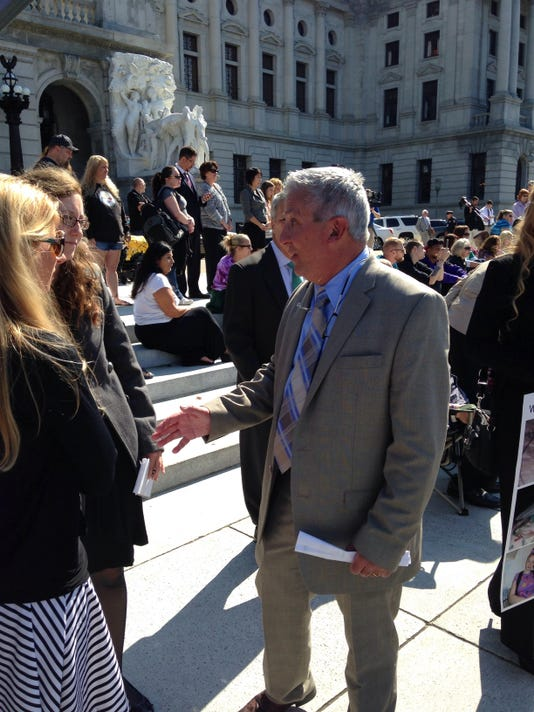 State Sen. Mike Folmer, R-Lebanon County, shakes hands with marijuana activists on the steps of the Pennsylvania Capitol in Harrisburg during a September 2014 medical marijuana rally. Folmer's Medical Cannabis Act, or Senate Bill 3, was introduced in the Senate in January.