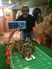 Taxidermist Nick Saade will sell his gridiron creation for $1,500.