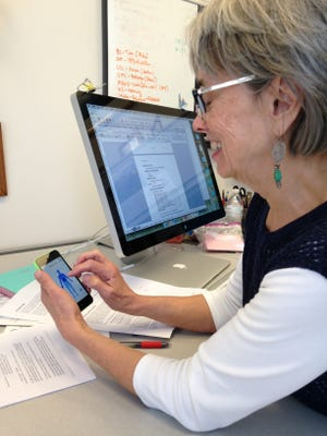 Marianne Berwick, PhD, of the University of New Mexico Comprehensive Cancer Center, uses the Mole Mapper app she helped create with a national team of melanoma scientists in collaboration with Apple Inc.