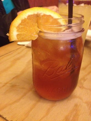 The Millionaire Moonshine at Hot Tails in New Roads is comprised of bourbon, peach preserves, lemonade and sweet tea.