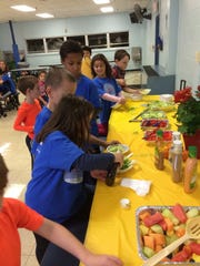 Children at the YMCA After School Program at Robert Hunter have healthy snacks.