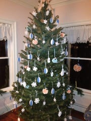 Christmas tree adorned with homemade snowflakes, Moravian stars and ribbon balls.
