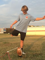 USJ sophomore kicker Charles Campbell practices his kick technique during practice Thursday.