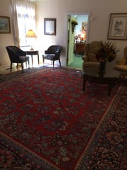 This Sarouk Oriental carpet in the entry way of the