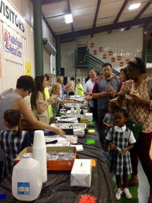 Grace Christian School students, parents and other community members celebrate Louisiana history with food and shopping at the school gym Thursday.