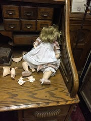 A broken baby doll in the main room in the Bissman