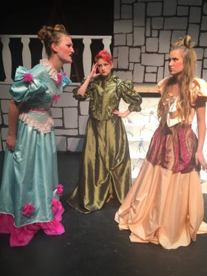 From left, Amanda Bock, playing a stepsister, Bridget Wilkin, playing the step-mother, and Becca Bischop, playing a step sister, reherse a scene from this year's Howell High School musical, Cinderella.
