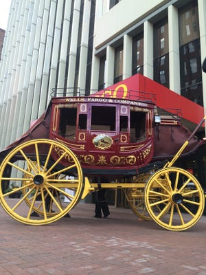 This file photo shows a Wells Fargo wagon outside of the bank's offices on Walnut Street in downtown Des Moines on Nov. 10, 2015.