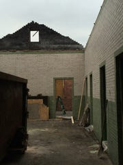 A portion of the roof has been removed because of damage,