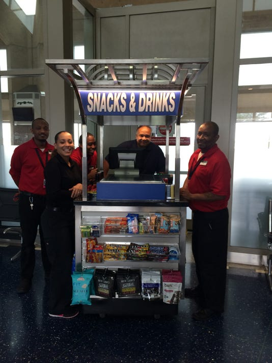 635827643394229004-A-Paradies-Lagard-re-Travel-Retail-At-Your-Service-cart-at-Kansas-City-International-Airport