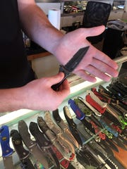 Brian Thompson, manager at Knifeworx, demonstrates
