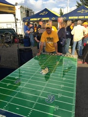 Kevin Miller of the fan message board bobcatnation.com has a custom beer pong table, painted to celebrate the dedication of the new field.