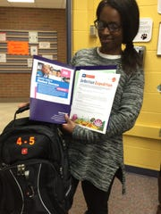 Hatty Ligon, homeless/parent coordinator for Farmington Public Schools, shows off some of the material contained in grade-appropriate backpacks available to borrow at the parent resource room.
