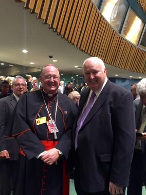 Bob Simpson with Timothy Dolan, Archbishop of New York.