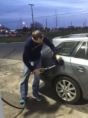 Nathan Kibler, 41, of Ferndale, fills his tank at a