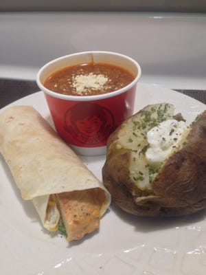 Make a healthier meal at Wendy's with a grilled chicken wrap, small chili and a baked potato with sour cream and chives.