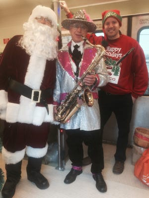 Santa and musicians entertain on PATCO 's Santa Sleigh, which this year will operate three times Dec. 5 from Camden County stations into Phildaelphia.