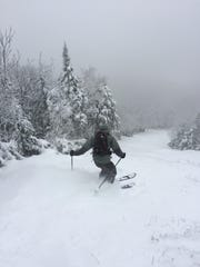 Telemark skier Michael Kavouksorian of Jericho makes turns on Saturday in boot-deep natural snow on Mt. Mansfield.