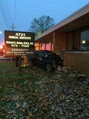 Officers and fire personnel found a black Jeep Grand Cherokee had smashed into a building at 4721 Dixie Highway on Saturday.