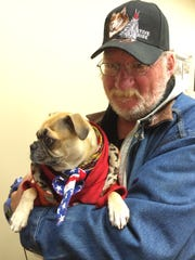 Harold Dunlap and Sophie are familiar faces at the Central Iowa Shelter and Services center on the south edge of downtown.
