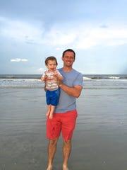 Adam Podlesh holds his son, Carter, 16 months.
