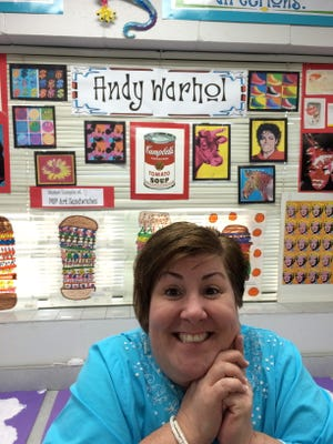 Artist and teacher Margie Grussing isn't afraid to smile for the camera.