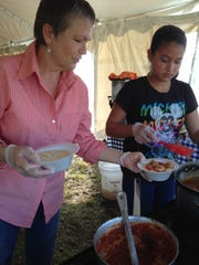 The Camellia Street Grill from Everglades City serves up traditional Florida Cracker food, such as this shrimp and grits, during the Swamp Heritage Festival at Big Cypress National Preserve.