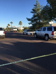 Phoenix police investigate the scene of an officer-involved