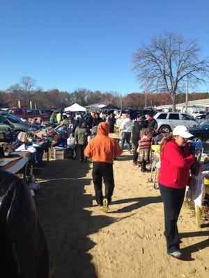 After 36 years in business, the Route 70 Auction & Flea Market in Lakewood still draws a large crowd of shoppers. A new proposal would  replace the landmark business with townhomes and retail space.