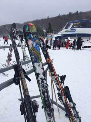 Ski and snowboard enthusiasts enjoy Bristol Mountain's slopes at the start of the 2014-15 season.