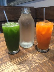 First Watch offers fresh juice, including the Kale Tonic, left, and Day Glow with oranges and carrots.