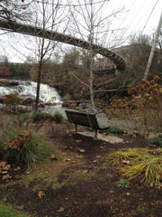 Liberty Bridge and Reedy River Falls command attention at Falls Park in Greenville, but the park is full of small treasures including Spring Falls, center.