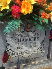 In this 2015 photo, Jessica Chambers' grave is adorned with all of her favorite things.