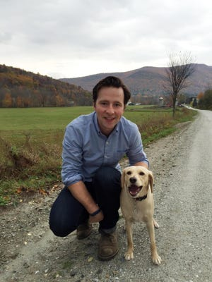 In this 2014 photo provided by James O'Connor, O'Connor and his dog, Charlie, pose for a photo in Arlington, Vt. There's a new way to decide whether a pricey, time-consuming trip to a pet ER is warranted, thanks to technology created for humans: telemedicine, which connects doctors with patients via smartphones, two-way video, email and other methods. In September 2015, O'Connor used telemedicine to help diagnose what was causing Charlie's persistent diarrhea.