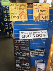 Although your dog or cat may not know what these signs say, owners who love their pets will