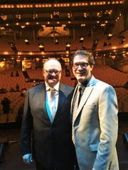 """Reporter Tom Mayhall Rastrelli, right, and his husband, conductor Bruce Mayhall Rastrelli, stand on the stage of Chicago's iconic Auditorium Theatre after Bruce conducted """"Lush Life: The Music of Billy Strayhorn"""" on Nov. 21. Strayhorn was one of the 20th century's greatest jazz composers."""
