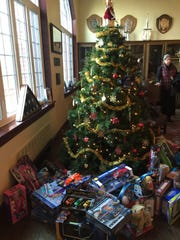Presents for area families sit under a tree at Fishburne