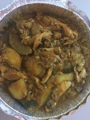 Chicken aqda is slow roasted with mixed vegetables.