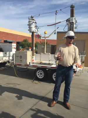 APS lineman Scott Kahrs showcases the effects of electrocution on APS safety trailer.
