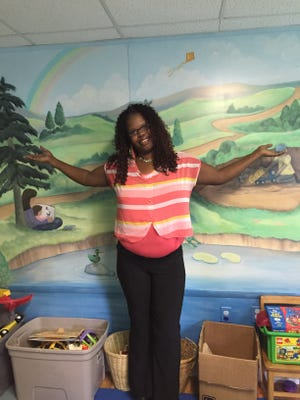 Cynthia Barthel returns to the children's room at the RAIHN day center. She was homeless last Christmas and now has an apartment.